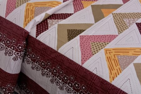 Rosee Triangle Shape Maroon Color Double Bed sheet Closeup